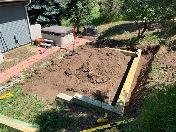 Level and Set Landscape Timbers for Retaining Wall
