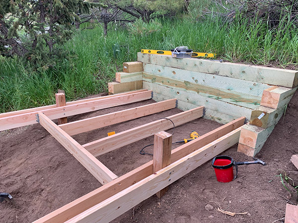 Setting Support Beams on 4x4 Treated Posts